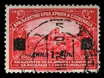 Stämpeln skrivev ut i kungarike av Serbien, Kroatien och Slovenien för fördelen av ogiltiga soldater Fotografering för Bildbyråer