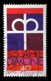 Stämpeln skrivev ut i Tyskland som var hängiven till den 125. årsdagen av den Diaconal anslutningen av den tyska protestantkyrkan Arkivbilder
