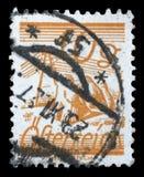 Stämpeln som skrivs ut i Österrike, är visade fält som korsas av telegraftrådar Royaltyfria Foton