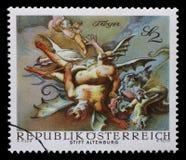 Stämpeln som skrivs ut i Österrike, visar besegrade demoner, vid Paul Troger, den Altenburg abbotskloster Royaltyfri Bild