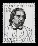 Stämpeln som skrivs ut i Jugoslavien, visar Franc Miklosic Royaltyfria Foton