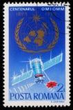 Stämpeln som skrivs ut i Rumänien, visar den 100. årsdagen av den meteorologiska organisationen för världen Arkivfoto