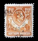 Stämpeln som skrivs ut i UK för den nordliga Rhodesia kolonin på nordliga Rhodesia shower, gör till kung Georg VI och djur Arkivfoton