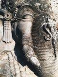 Stäng sig upp av den hinduiska gudGanesha lorden av vishet arkivfoton