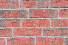 Stäng sig upp av den röda och gråa tegelstenväggen royaltyfria bilder
