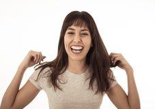 Stäng sig upp av den unga gladlynta kvinnan som ler och firar Mänskliga uttryck och sinnesrörelser royaltyfri bild