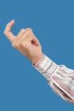 Stäng sig upp av en hand som gör en gest med ett finger Royaltyfri Foto