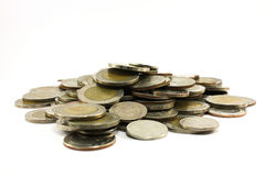 Stäng sig upp av ett materiel av thai mynt Arkivbilder