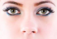 Stäng sig upp av framsida med makeup Royaltyfri Fotografi