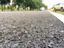 Stäng sig upp av Paved vägar och landningsbanor, bakgrundsträdgård royaltyfri bild
