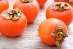 Stäng sig upp av persimmonfrukter Royaltyfri Fotografi