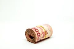 Stäng sig upp av Thailand valuta, thai baht med bilderna av den Thailand konungen Valör av 100 bahter på vit bakgrund Royaltyfri Foto