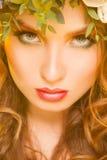 Stäng sig upp bild av den attraktiva kvinnan med blommor Fotografering för Bildbyråer