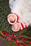 Stäng sig upp bild av nyfött behandla som ett barn fot, jultid Fotografering för Bildbyråer