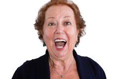 Stäng sig upp den chockade kvinnan som ser kameran Arkivfoto