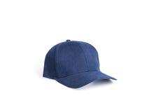Stäng sig upp den nya blåa baseballhatten som isoleras på vit arkivfoto
