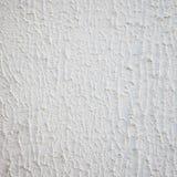 Stäng sig upp den texturerade vita väggen med kopieringsutrymme Royaltyfri Fotografi