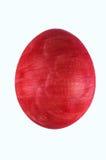 Stäng sig upp det röda ägget som isoleras på vit bakgrund Royaltyfri Foto