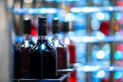 Stäng sig upp flaskor av alkohol royaltyfria foton
