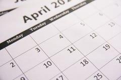 Stäng sig upp kalender av sidaApril bakgrund, skattsäsong royaltyfri foto