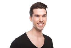 Stäng sig upp ståenden av attraktivt le för ung man royaltyfria foton