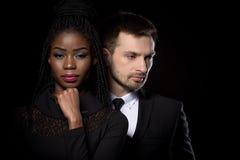 Stäng sig upp ståenden av den mång- etniska mannen och kvinnan Fotografering för Bildbyråer