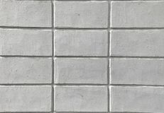 Stäng sig upp textur av den vita tegelstenväggen för bakgrund arkivbilder