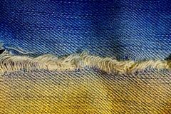 Stäng upp blå och orange jeans bakgrund och textur fotografering för bildbyråer