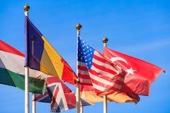 Stäng upp sikt av flaggor av olika länder royaltyfri bild