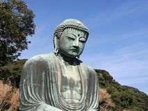 Stäng upp till huvudet av den stora Buddha i Kamakura Fotografering för Bildbyråer