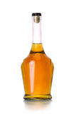 Stängd flaska av konjak på vit bakgrund Royaltyfria Bilder