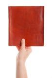 stängd hand för bok Arkivbilder