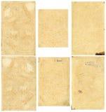 Stängd sömlös bild av ett ark av gammalt gulnat papper med mörka bruna fläckar, spår av tid Arkivbilder
