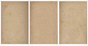 Stängd sömlös bild av ett ark av gammalt gulnat papper med mörka bruna fläckar, spår av tid Royaltyfri Fotografi