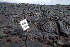 Stängd väg tack vare Lava Flow Arkivfoton