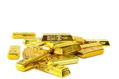 stänger fejkar isolerade guldtackor Arkivbild