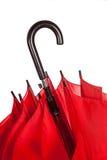 Stängt rött paraplyhandtag över vit Royaltyfri Foto