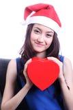 Stängt upp asiatisk kvinna med en julhatt Arkivfoton
