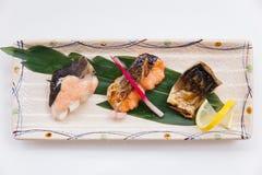 Stängt upp Salmon Teriyaki inkludera tre stycken av Roasted laxen med Teriyaki sås royaltyfri bild