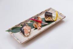 Stängt upp Salmon Teriyaki inkludera tre stycken av Roasted laxen med Teriyaki sås arkivfoton