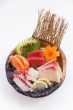 Stängt upp Sashimiuppsättning inkludera laxen, Hamachi, Toro och tioarmade bläckfisken arkivfoto