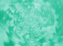 Stängt upp spiral och textur av havsskalet för konung Helmet Conch i grön färg för mintkaramell Royaltyfria Bilder