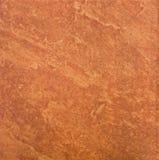 Stängt upp textur av den bruna ceremic tegelplattan Arkivfoton