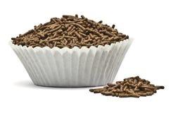Stänk i en muffin bildar spillt över fotografering för bildbyråer