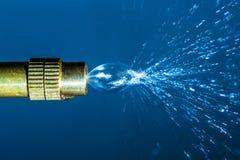 Stänkhuvud som besprutar vatten Royaltyfria Bilder