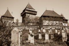 Stärkt kyrka av Viscri, Transylvania - Sepia royaltyfria foton