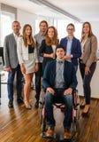 Stående av affären Team With Wheelchair Arkivfoton