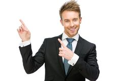 Stående av affärsmannen som pekar handgest arkivfoton