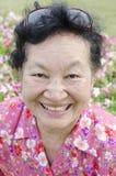 Stående av asiatisk åldring på parkera Royaltyfria Foton