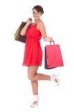 Stående av att bedöva den unga kvinnan med shoppingpåsen Royaltyfria Foton